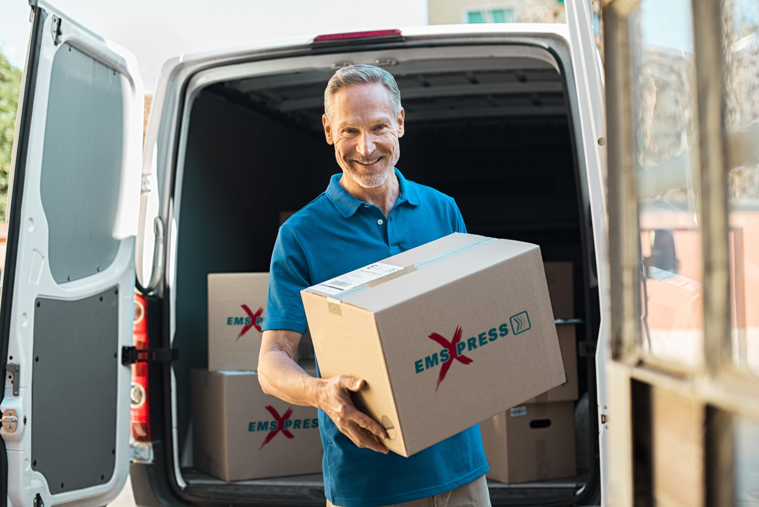 Delivery man holding parcel